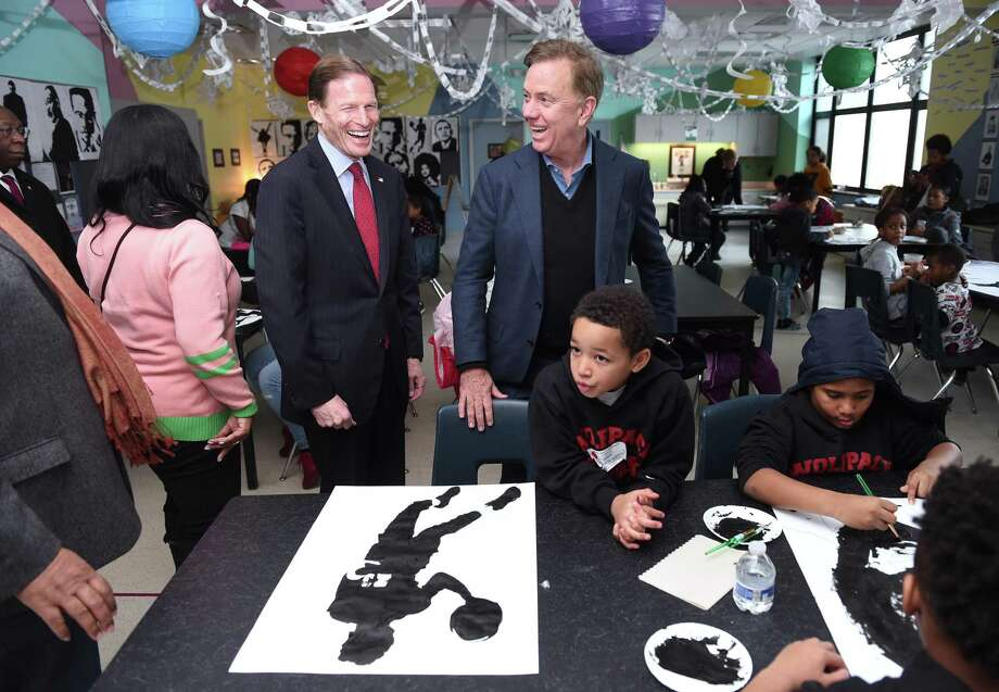 U.S. Sen.  Richard Blumenthal, center left, and  Gov. Ned Lamont, center right, tour a classroom working on elements for a mural at the annual Martin Luther King Conference at Wexler-Grant Community School in New Haven Monday. Working at the table are Ricardo Hilton, center, 8, and Douglas Taylor,8, of New Haven. Photo: Arnold Gold / Hearst Connecticut Media / New Haven Register