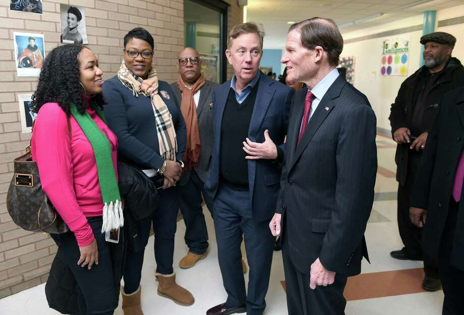 Governor Ned Lamont (center) and U.S. Senator Richard Blumenthal (right) visit the annual Dr. Martin Luther King, Jr. Conference at Wexler-Grant Community School in New Haven on January 21, 2019. From left are Medria Blue-Ellis, principal of ESUMS, magnet resource coordinator Alice Coleman, Scot X. Esdaile, president of the Connecticut State Conference of the NAACP, Lamont and Blumenthal. Photo: Arnold Gold / Hearst Connecticut Media / New Haven Register