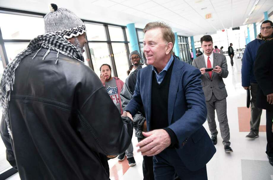 Maurice Williams of New Haven (left) greets Governor Ned Lamont (center) at the annual Dr. Martin Luther King, Jr. Conference at Wexler-Grant Community School in New Haven on January 21, 2019. Photo: Arnold Gold / Hearst Connecticut Media / New Haven Register