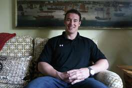 Former Navy SEAL Carl Higbie, photographed at his mother's home in Greenwich on Thursday, April 28, 2016. He is organizing a panel discussion on the issue of the day at 7 p.m. Jan. 30 at Town Hall.