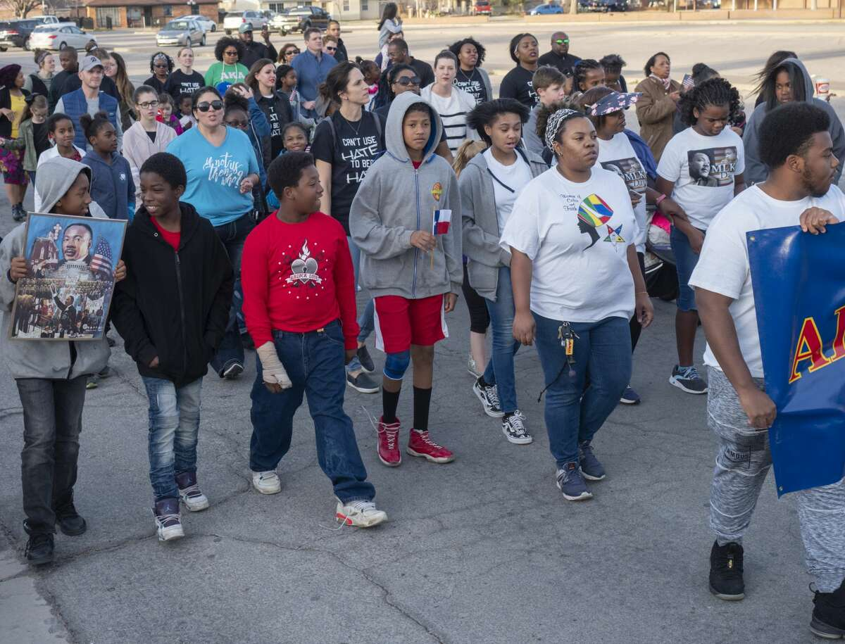 Midlanders come together 01/21/19 to march in commemoration of Martin Luther King Jr.. Tim Fischer/Reporter-Telegram