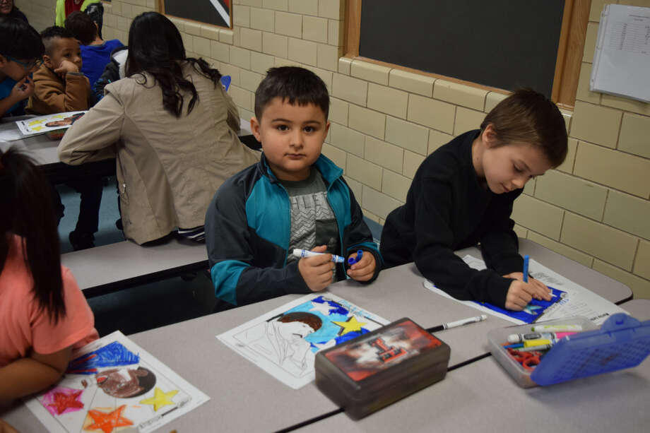 Hillcrest second graders completed coloring pages after listening to a story about the life of MLK during an event hosted by the Hale County Literacy Council and the Runningwater Draw RSVP on Friday morning. Photo: Ellysa Harris/Plainview Herald