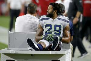 File-This Sept. 30, 2018, file photo shows Seattle Seahawks defensive back Earl Thomas (29) leaving the field after breaking his leg against the Arizona Cardinals during the second half of an NFL football game, Sunday, Sept. 30, 2018, in Glendale, Ariz.  Injuries are never an excuse. Not for players. Not for coaches. And not for fans. Still, the NFL teams that have the most success almost always keep their best players on the field. For some teams such as Atlanta, Jacksonville and Cincinnati, injuries were a factor in derailing their seasons.(AP Photo/Ross D. Franklin, File)