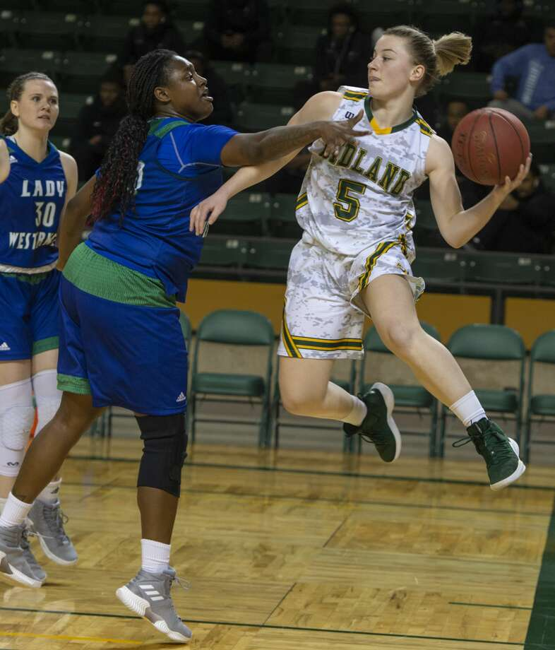 Midland College's Grace Beasley looks to pass after driving baseline around Western Texas' Ashlan Smith 01/21/19 at  the Chaparral Center. Tim Fischer/Reporter-Telegram Photo: Tim Fischer/Midland Reporter-Telegram