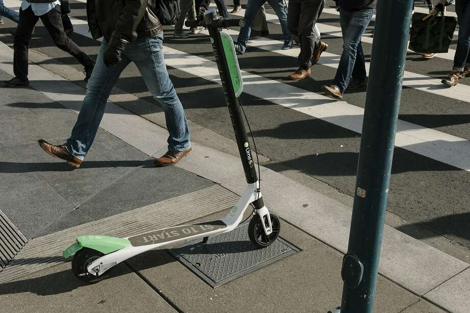 FILE — A Lime scooter on the Embarcadero in San Francisco, April 16, 2018. Mark Sands, a 21-year-old exchange student from Ireland who died Feb. 2, 2019, now holds the tragic distinction of becoming the first Austin resident killed in an accident involving an electric scooter. Photo: Jason Henry, NYT
