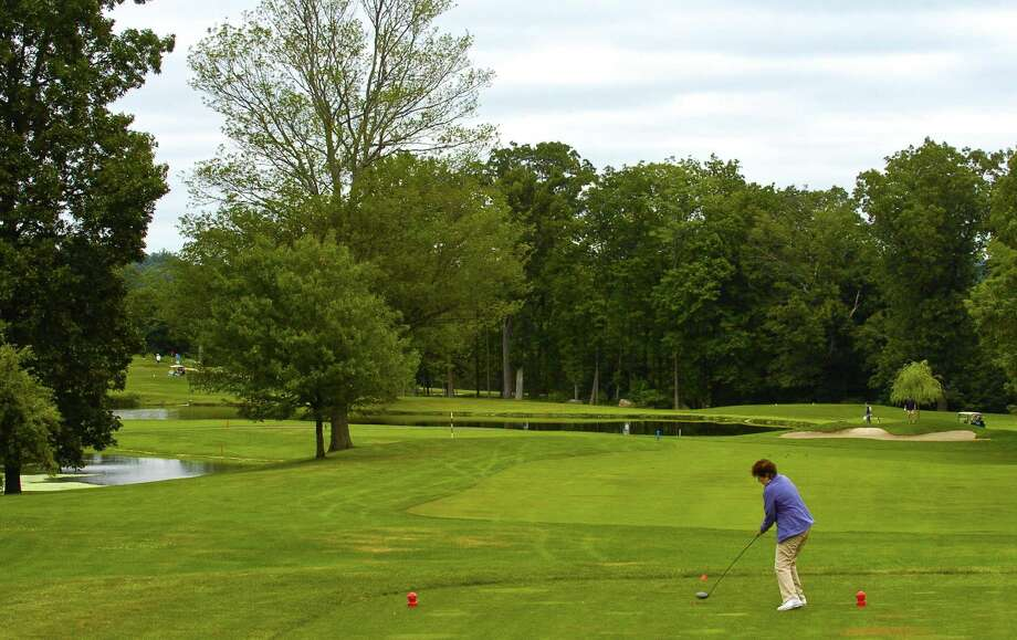 A golfer tees off at Sterling Farms Golf Course in Stamford. Board of Representatives' Parks & Recreation Committee will hold a public hearing 7 p.m. Tuesday on proposed permit hikes at the city's public courses. Photo: Matthew Brown / Hearst Connecticut Media / Stamford Advocate