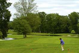 A golfer tees off at Sterling Farms Golf Course in Stamford. Board of Representatives' Parks & Recreation Committee will hold a public hearing 7 p.m. Tuesday on proposed permit hikes at the city's public courses.