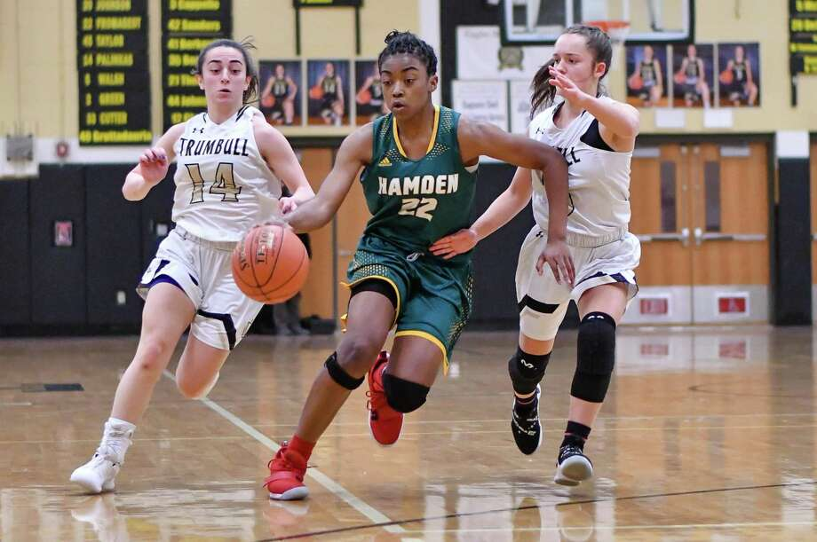 Taniyah Thompson (22) of the Hamden Green Dragons brings the ball up the floor during a game against the Trumbull Eagles on Monday January 21, 2019 at Trumbull High School in Trumbull, Connecticut. Photo: Gregory Vasil / For Hearst Connecticut Media / Connecticut Post Freelance