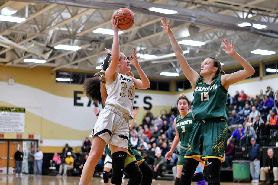 Allie Palmieri (30) of the Trumbull Eagles shoots over Rebecca Oberman (15) of the Hamden Green Dragons during a game played on Monday January 21, 2019 at Trumbull High School in Trumbull, Connecticut. Photo: Gregory Vasil / For Hearst Connecticut Media / Connecticut Post Freelance