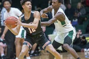 Albany Academy sophomore Marcus Jackson, left, goes against Green Tech junior Mazziah Thorpe during the Slam North South Classic at Washington Avenue Armory on Saturday, Jan. 19, 2019. (Jim Franco / Special to the Times Union)