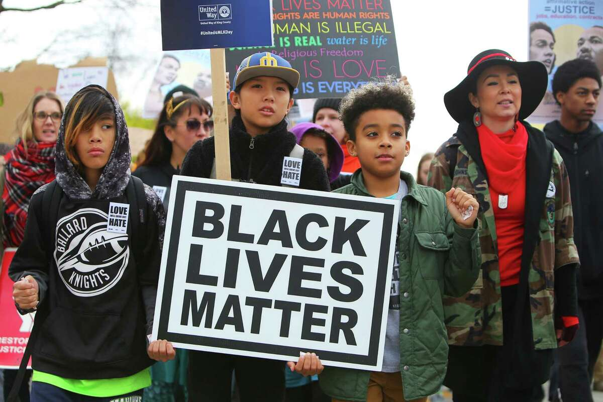 Thousands march from Garfield High School to Westlake Park as a part of Seattle's annual Martin Luther King Jr. Day celebration, Monday, Jan. 21, 2019. Other MLK Day events included rallies, an opportunity fair, workshops and youth activities.