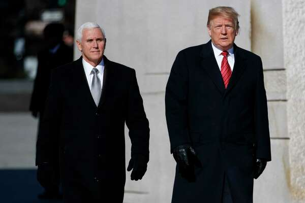 President Donald Trump and Vice President Mike Pence visit the Martin Luther King Jr. Memorial, Monday, Jan. 21, 2019, in Washington.