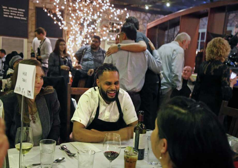 Instead of serving Patty Mills joined a table to chat. San Antonio Spurs coaches and players serve food and wine tonight at the 8th annual Champions Against Hunger Dinner, a fund-raiser for the San Antonio Food Bank on Monday, January 21, 2019 the Grill at Leon Springs Photo: Ronald Cortes/Contributor / 2019 Ronald Cortes