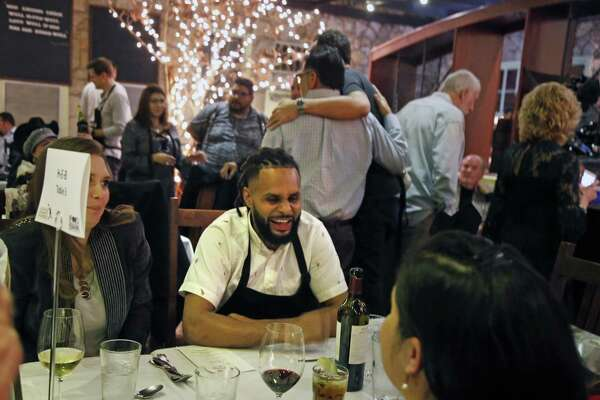 Instead of serving Patty Mills joined a table to chat. San Antonio Spurs coaches and players serve food and wine tonight at the 8th annual Champions Against Hunger Dinner, a fund-raiser for the San Antonio Food Bank on Monday, January 21, 2019 the Grill at Leon Springs