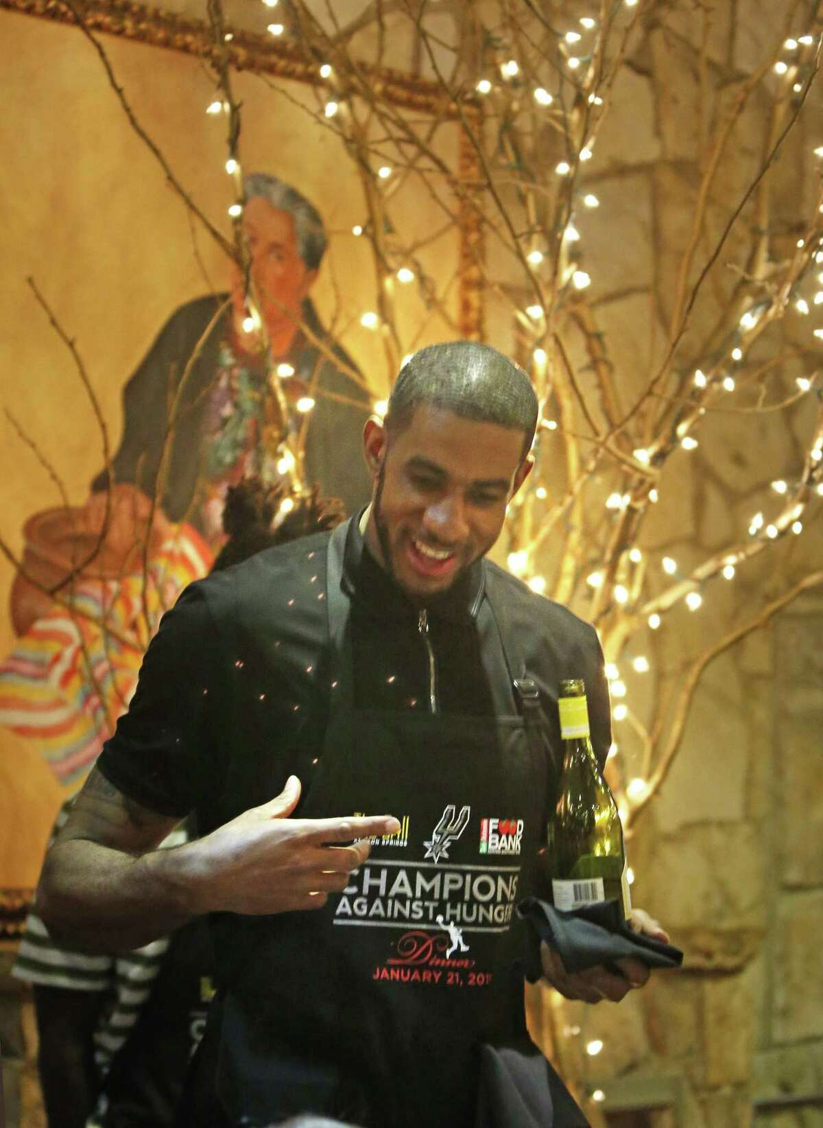 LaMarcus Aldridge prepares to serve wine. San Antonio Spurs coaches and players serve food and wine tonight at the 8th annual Champions Against Hunger Dinner, a fund-raiser for the San Antonio Food Bank on Monday, January 21, 2019 the Grill at Leon Springs