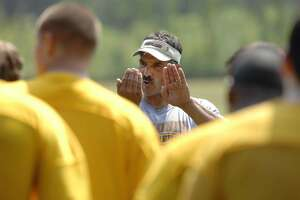 Colonie football head coach Mike Ambrosio gives instructions to his players during Colonie High School football practice in Colonie , NY on Monday, Aug. 17, 2009.   (Paul Buckowski / Times Union)