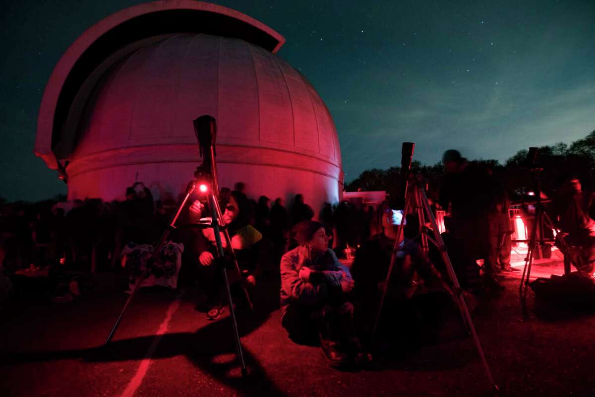 Astronomy enthusiasts and photographers came with their gear to view and document the Super Blood Wolf Moon at the George Observatory in the Brazos Bend State Park, Sunday, Jan. 20, 2019.