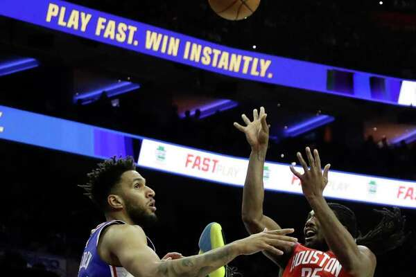 Houston Rockets' Kenneth Faried, right, goes up for a shot against Philadelphia 76ers' Jonah Bolden during the first half of an NBA basketball game, Monday, Jan. 21, 2019, in Philadelphia. (AP Photo/Matt Slocum)
