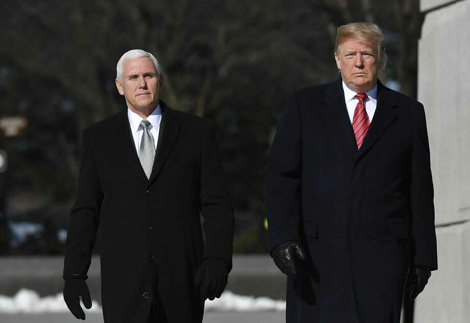 US President Donald Trump and US Vice President Mike Pence(L) visit the Martin Luther King Jr. Memorial in Washington, DC on Martin Luther King Day on January 21, 2019. (Photo by MANDEL NGAN / AFP)MANDEL NGAN/AFP/Getty Images Photo: Mandel Ngan /AFP /Getty Images / AFP or licensors