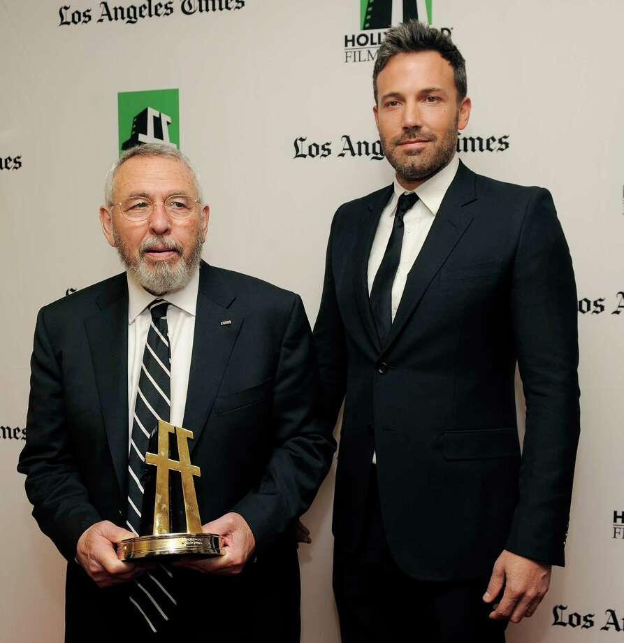 """Ben Affleck, right, a cast member and director of the film """"Argo,"""" poses with former C.I.A. agent Tony Mendez, whom he portrays in the film, backstage at the 16th Annual Hollywood Film Awards Gala on Monday, Oct. 22, 2012, in Beverly Hills, Calif. (Photo by Chris Pizzello/Invision/AP) Photo: Chris Pizzello / Invision"""