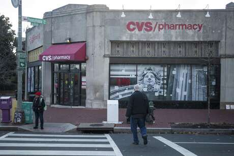 San Antonio's CaptureRx has sued CVS Health Corp., alleging antitrust violations. Pedestrians walk past a CVS store in December in Washington, D.C.
