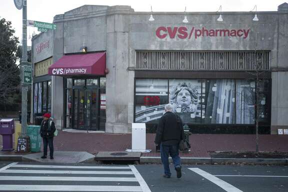 San Antonio's CaptureRx has sued CVS Health Corp., alleging antitrust violations. Pedestrians walk past a CVS store in December in Washington, D.C.
