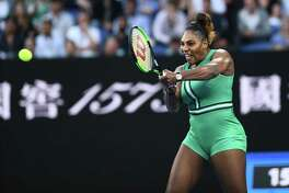 Serena Williams of the US hits a return against Romania's Simona Halep during their women's singles match on day eight of the Australian Open tennis tournament in Melbourne on January 21, 2019. (Photo by Jewel SAMAD / AFP) / -- IMAGE RESTRICTED TO EDITORIAL USE - STRICTLY NO COMMERCIAL USE --JEWEL SAMAD/AFP/Getty Images