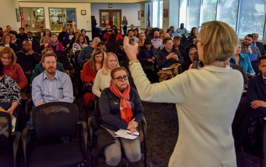 Nargess Lakehal-Ayat, seated in center, a language and culture instructor with the State Department, attends a Fairfax County Public Schools substitute-teacher hiring event for furloughed federal government workers at Fairfax County Public Schools headquarters on Friday, Jan. 11, 2019, in Falls Church, Virginia. Photo: Washington Post Photo By Jahi Chikwendiu. / The Washington Post