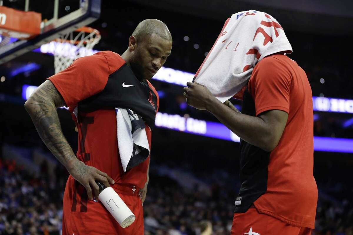 The Rockets' James Harden, right, and P.J. Tucker discuss the worsening situation during a second-half timeout Monday.