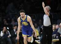 Golden State Warriors' Klay Thompson reacts after making a 3-point basket against the Los Angeles Lakers during the first half of an NBA basketball game, Monday, Jan. 21, 2019, in Los Angeles. (AP Photo/Marcio Jose Sanchez)