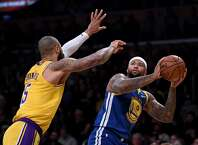 LOS ANGELES, CALIFORNIA - JANUARY 21:  DeMarcus Cousins #0 of the Golden State Warriors prepares a fade away jumper in front of Tyson Chandler #5 of the Los Angeles Lakers during the first half at Staples Center on January 21, 2019 in Los Angeles, California.  NOTE TO USER: User expressly acknowledges and agrees that, by downloading and or using this photograph, User is consenting to the terms and conditions of the Getty Images License Agreement. (Photo by Harry How/Getty Images)