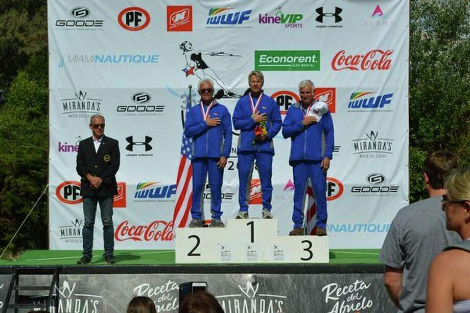 Dan Wamhoff, center stands atop the podium after winning his division at the Water Ski World Championships last December in Chile, as the U.S. national anthem is played. The top three finishers were all from the United States. (Photo provided)