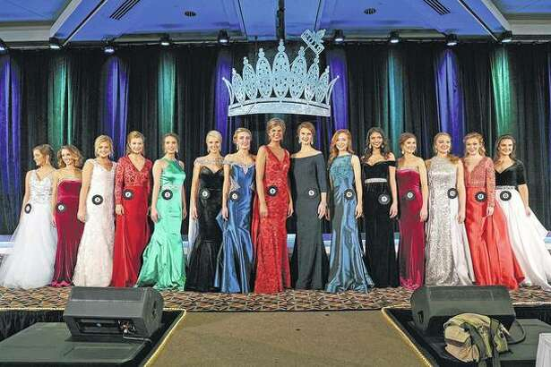 The top 15 contestants pose in their evening gowns during Sunday's final competition. Miss Morgan County Fair Savanna Long is third from left; Miss Cass County Fair Lexi Carlock is fourth from right. Contestant No. 6, Alexi Bladel, sixth from left, was chosen as the 2019 queen.