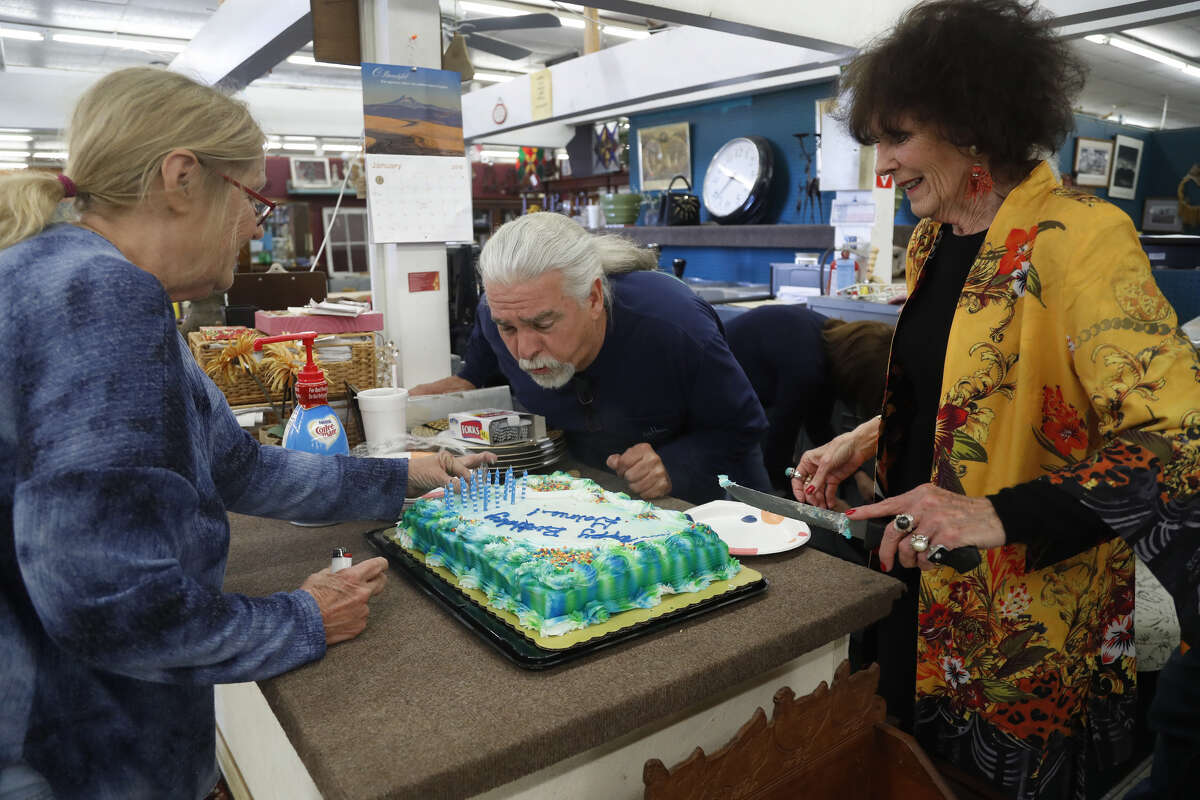 Gaines Andrews, owner of Alvin Antique Center and Marketplace at 2500 S. Loop 35, blows out candles on his birthday cake, Saturday, Jan. 19, 2019, in Alvin.