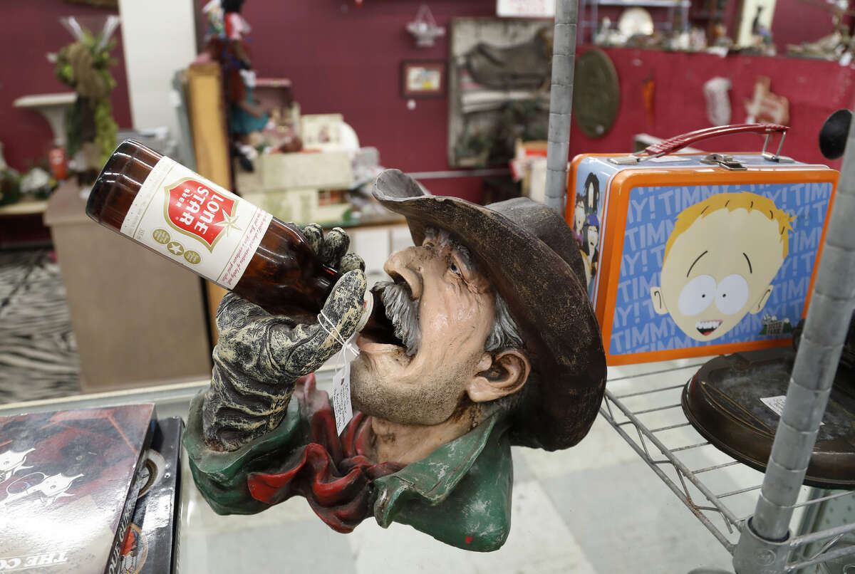 A Lone Star chugging cowboy bottle holder on display in a booth at the Alvin Antique Center and Marketplace at 2500 S. Loop 35, Saturday, Jan. 19, 2019, in Alvin.