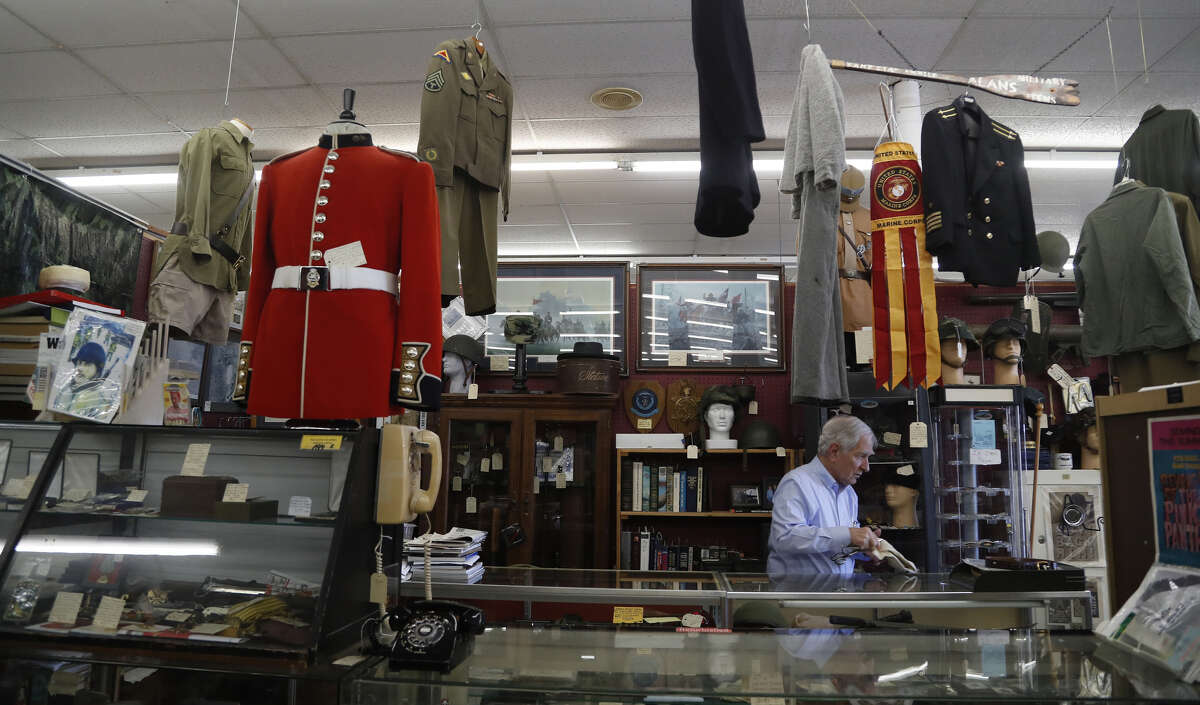 Alan Coburn in his military-themed booth at the Alvin Antique Center and Marketplace at 2500 S. Loop 35, Saturday, Jan. 19, 2019, in Alvin.