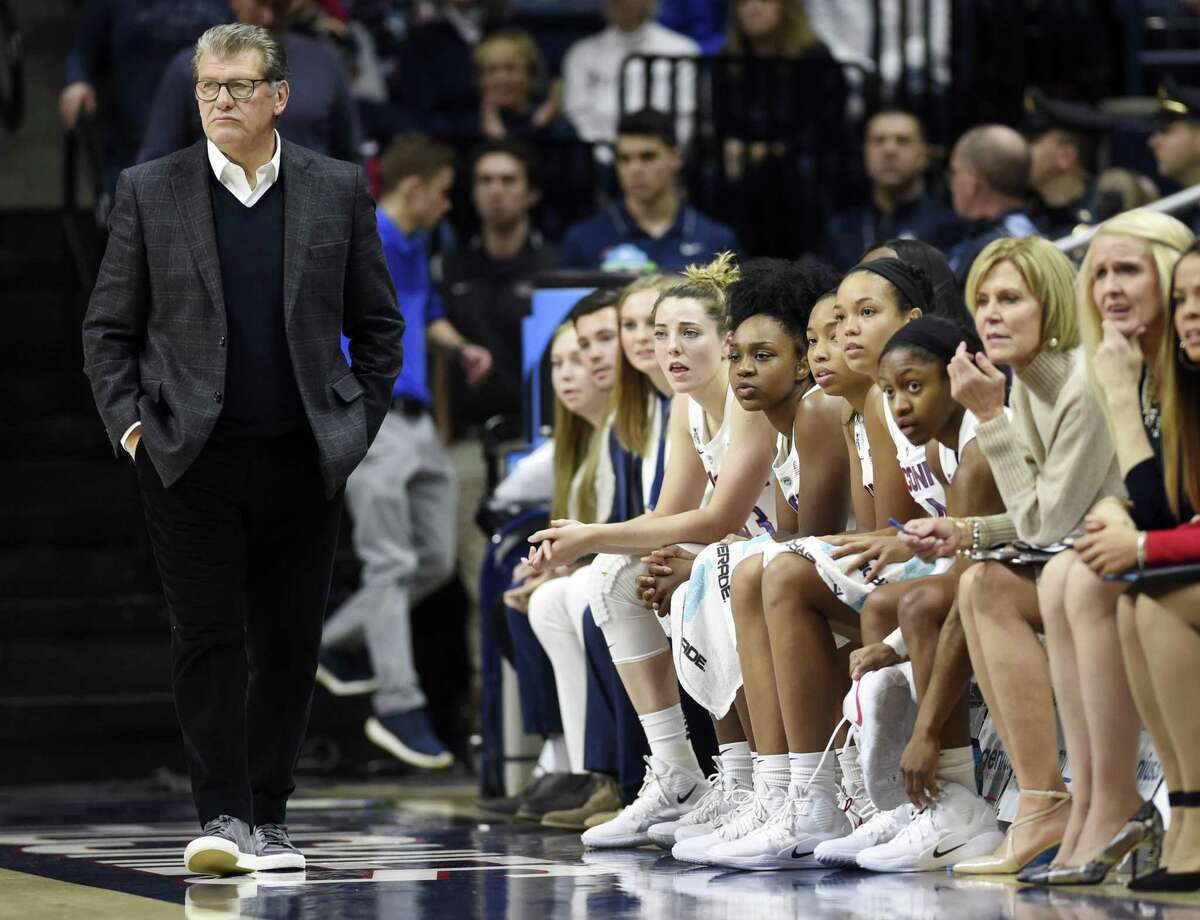 All five Connecticut starters sit on the bench after head coach Geno Auriemma, left, pulled them early in the first half of anNCAA college basketball game against South Florida, Sunday, Jan. 13, 2019, in Storrs, Conn. (AP Photo/Stephen Dunn)