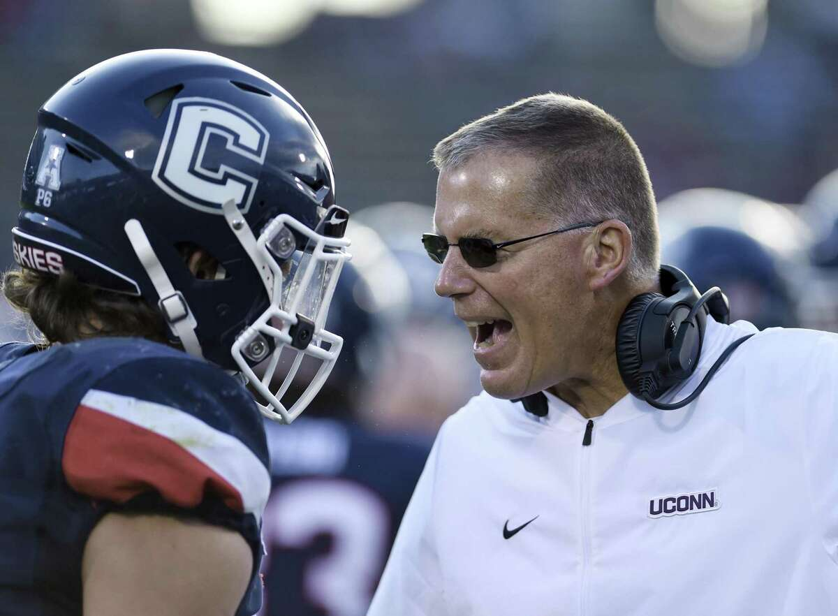 Connecticut coach Randy Edsall talks to one of his players during a game in September.
