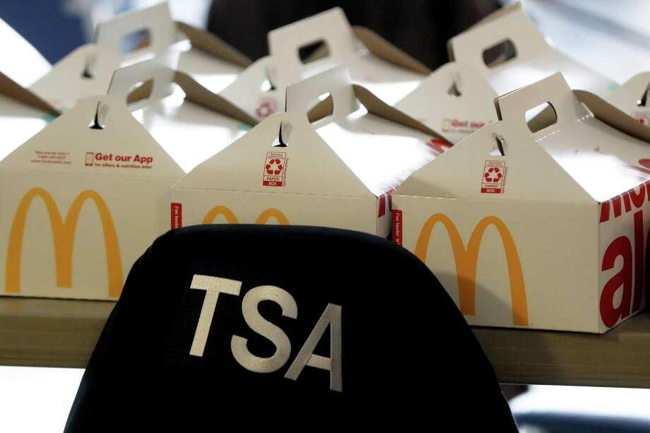 A TSA jacket is over the back of a chair in the TSA break room in front of donated boxes of meals from the McDonald's in the airport food court at the Pittsburgh International Airport, in Imperial, Pa. on Friday, Jan. 18, 2019. Because of the partial government shutdown, the restaurant has donated meals to the TSA workers. (AP Photo/Keith Srakocic) Photo: Keith Srakocic / Associated Press / Copyright 2019 The Associated Press. All rights reserved