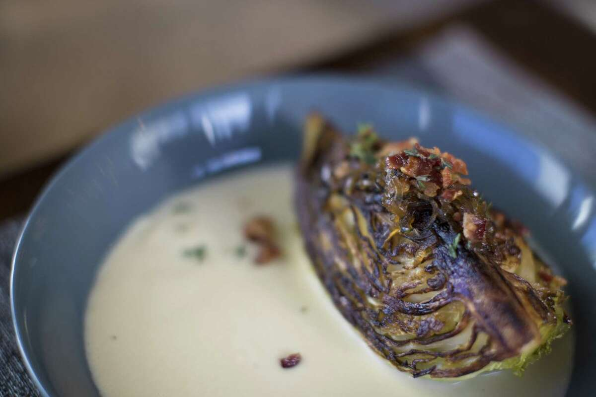 Cabbage Wedge with bacon-shallot vinaigrette and onion soubise at Kulture
