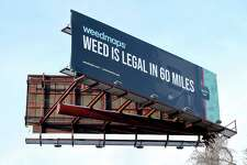 A billboard advertising marijuana in Massachusetts faces travelers on northbound I-91 in New Haven on January 21, 2019.