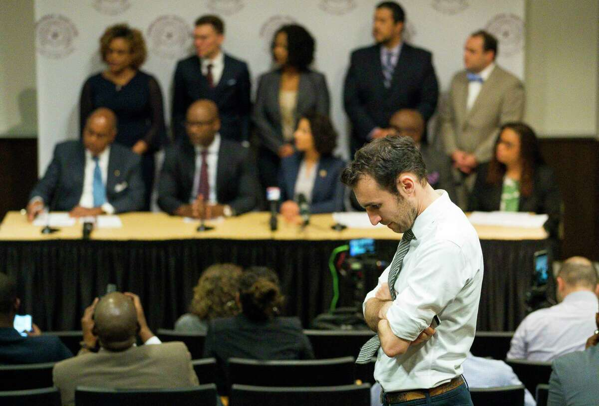 Alec Karakatsanis, who led a class-action lawsuit against the county on behalf of indigent defendants challenging the county's cash bond system, listens to a press conference regarding new bail reforms at Texas Southern University in Houston on Jan. 17, 2019. The new rule has allowed qualifying misdemeanor defendants to be released on a personal bond rather than a cash bond.