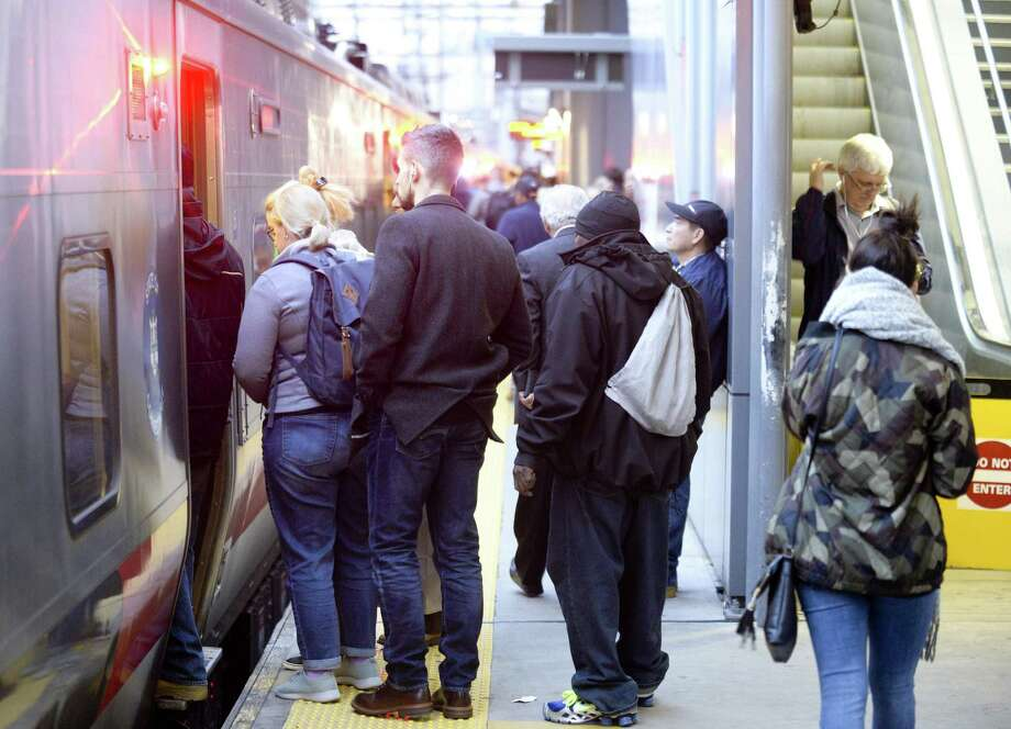 Commuters board a Metro-North train at the Stamford train station in October. Photo: Matthew Brown / Hearst Connecticut Media / Stamford Advocate