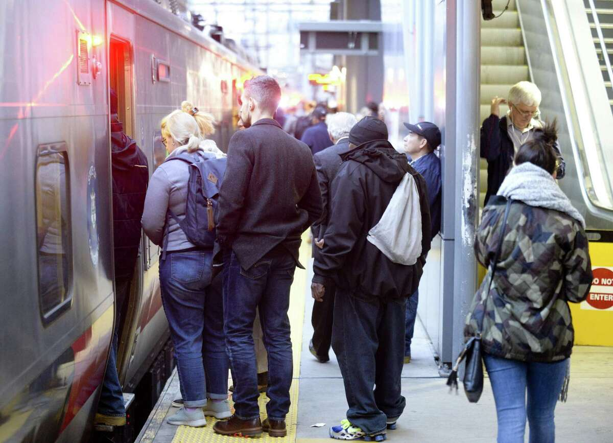 Commuters board a Metro-North train at the Stamford train station.