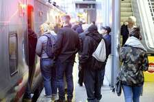 Commuters board a Metro-North train at the Stamford train station in October.