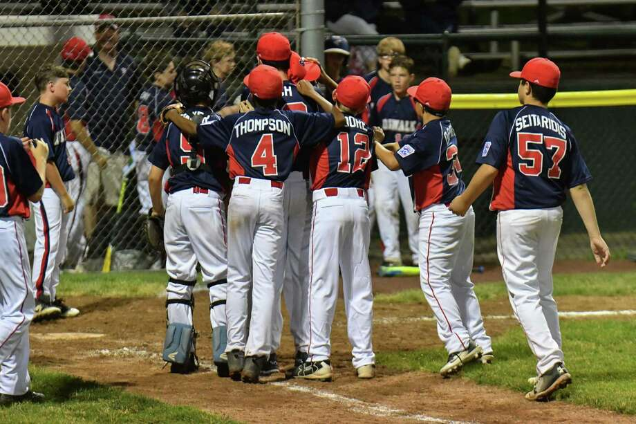 Members of North Stamford celebrate a 4-2 win over Norwalk during a District 1 Little League game in 2018. Registration is now available for Stamford North Little League's upcoming season. Photo: Gregory Vasil / For Hearst Connecticut Media / Connecticut Post Freelance