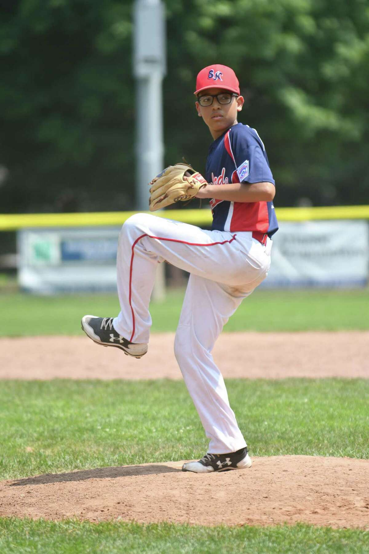 Joe Colon (21) of Stamford North delivers a pitch during a District 1 Little League game against Weston on Wednesday July 4, 2018, at Michael J. Drotar Park in Stamford, Connecticut.