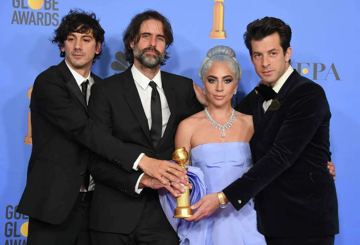 FILE - In this Jan. 6, 2019 file photo, Anthony Rossomando, from left, Andrew Wyatt, Lady Gaga and Mark Ronson pose in the press room with the award for best original song, motion picture for
