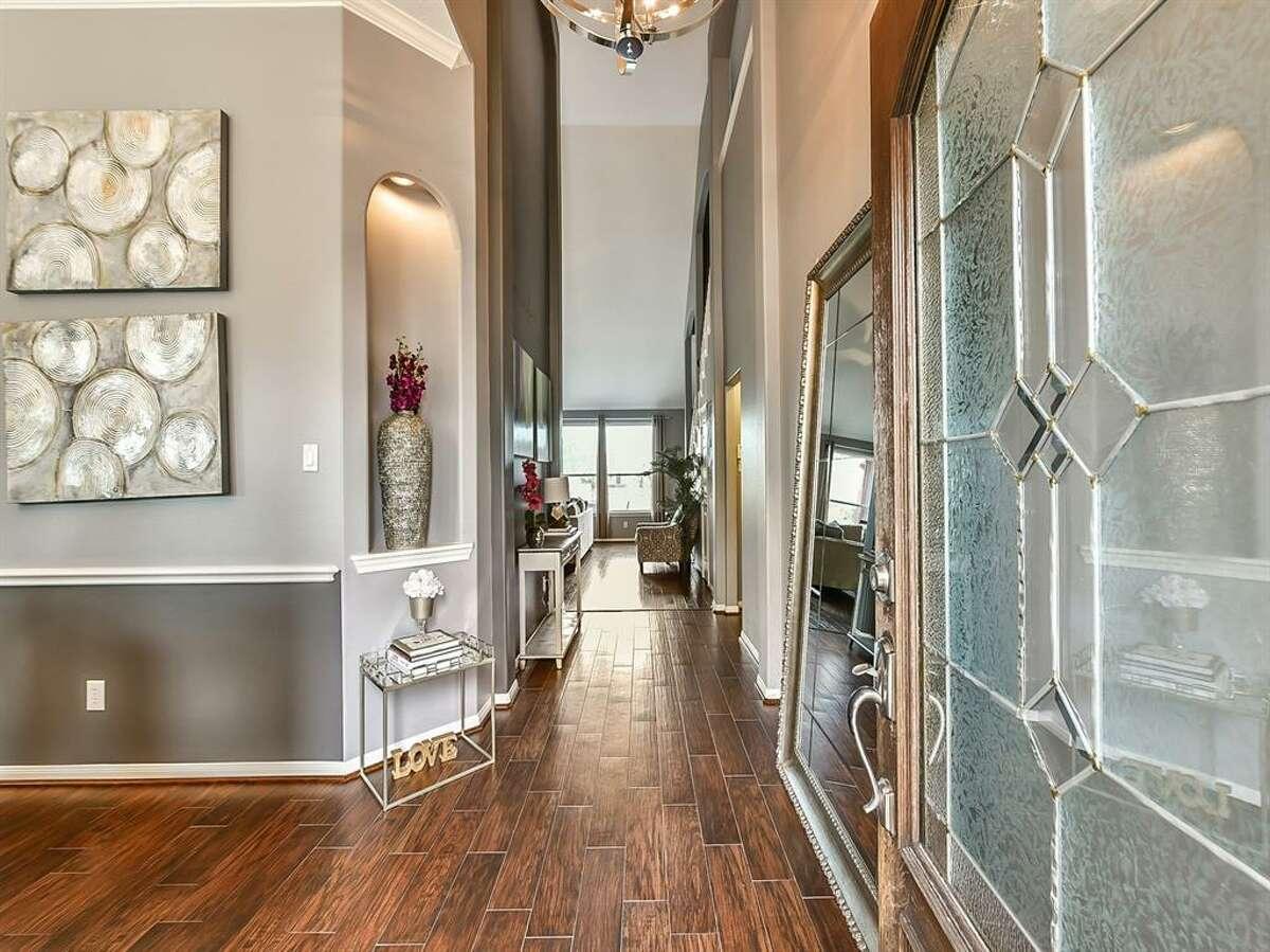 PEARLAND:215 Walnut Cove Listing price: $292,500 Square feet: 2,429 Price per square foot: $120