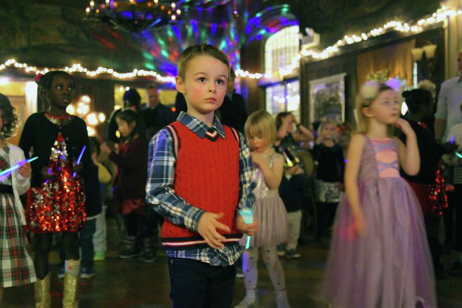 Joshua Swift, 4, of New Canaan, enjoys the party at the New Year's Eve Family Fun Night at Waveny House, Monday, Dec. 31, 2018, in New Canaan, Conn. Photo: Jarret Liotta / For Hearst Connecticut Media / New Canaan News Freelance